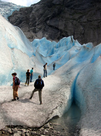 field researchers on glacier
