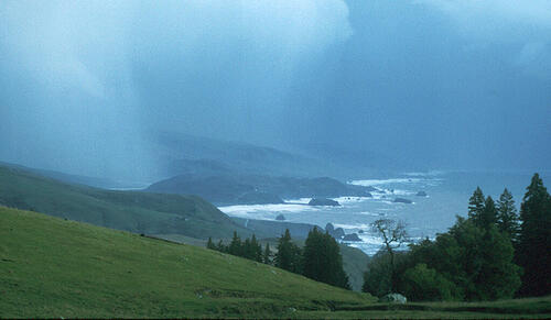 """A storm darkens the sky at the mouth of the Russian River, north of Bodega Bay, Calif. The storm was driven largely by an """"atmospheric river"""" over California. (Image courtesy of National Oceanic and Atmospheric Administration)"""